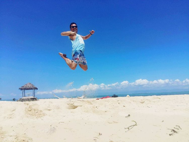 Unlimited jump... Beach Jumping Sand Activity Summer Leisure Activity Outdoors Blue Fun Mid-air Motion Full Length Enjoyment People