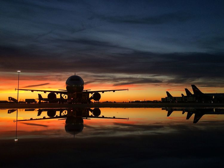 Aircraft reflection Water Reflection Sunset Silhouette Lake Waterfront Orange Color Scenics Cloud - Sky Calm Tranquility Building Exterior Tranquil Scene Sky Beauty In Nature Standing Water Nature Planespotting Plane Sheremetyevo Airport Aviationphotography Airbus A320 Airbus Dramatic Sky Outdoors