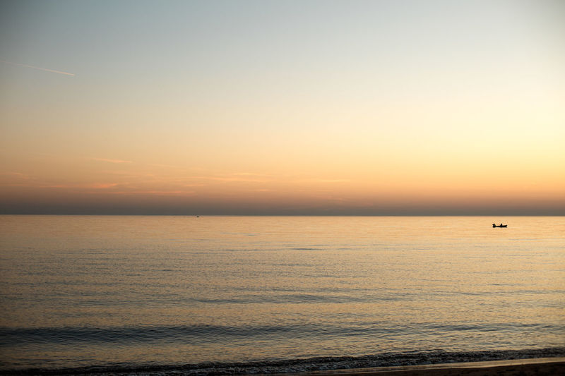 Sky Scenics - Nature Sea Water Sunset Horizon Over Water Horizon Beauty In Nature Tranquil Scene Tranquility Waterfront Orange Color Nature Idyllic No People Copy Space Seascape Clear Sky Outdoors
