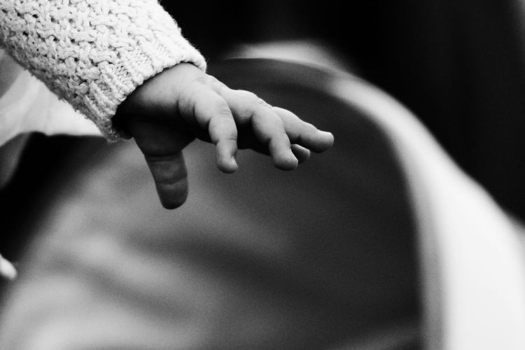 Cropped image of baby hand