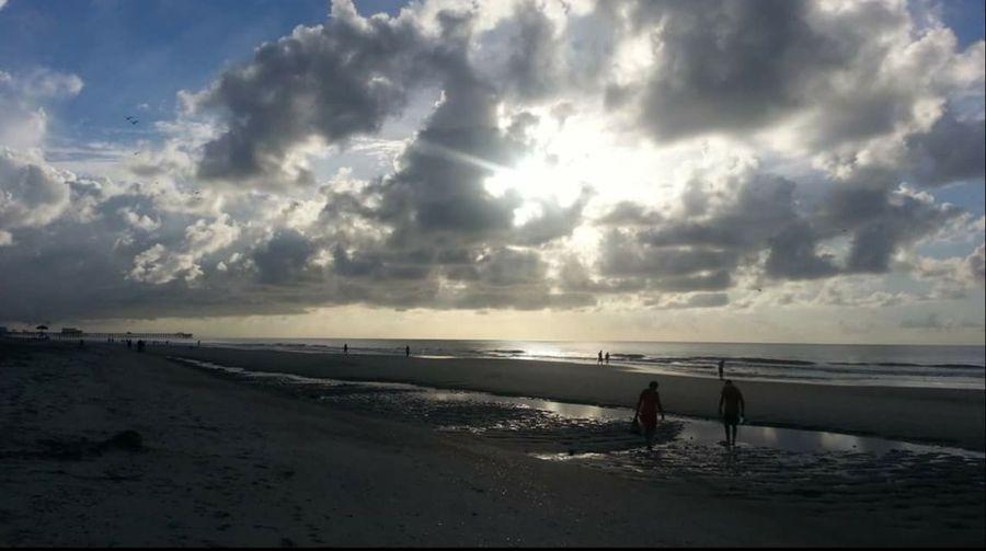 Beach clouds sun