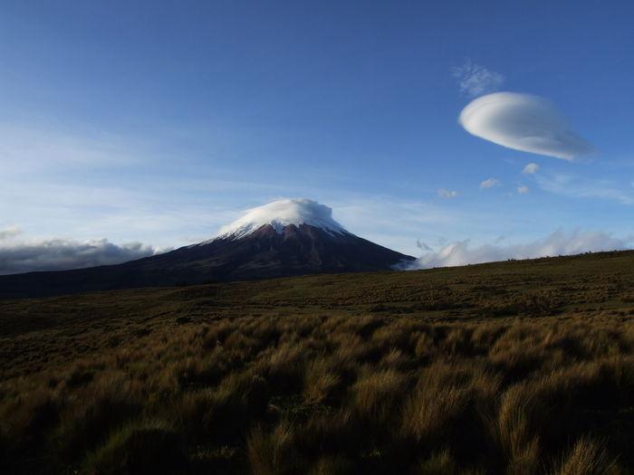 Active volcano cotopaxi, ecuador, with storm cloud