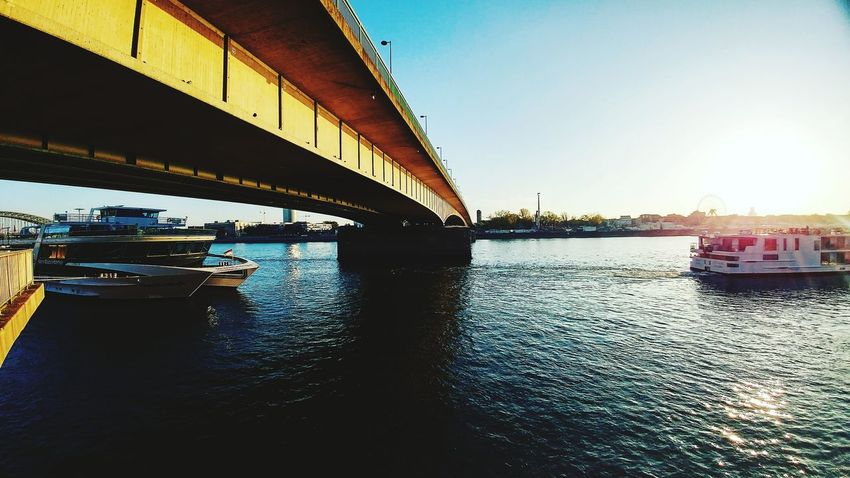 Bridge - Man Made Structure Water River Connection Architecture Built Structure Transportation Nautical Vessel City Clear Sky No People Day Sky Cloud - Sky Scenics Cityscape Panoramic Shot Idyllic Water Surface Tranquility Reflection Majestic City Modern Sun