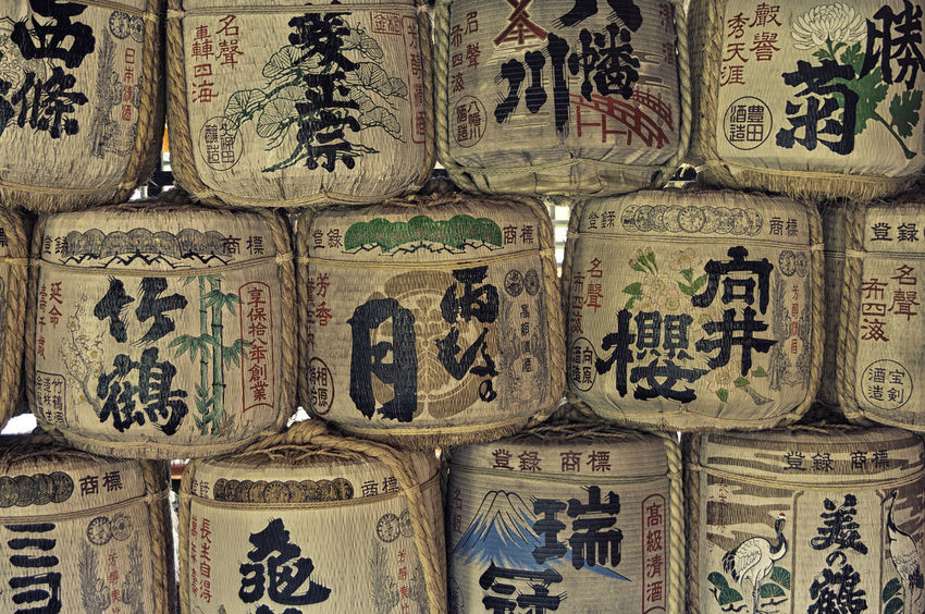 A wall of colorful painted Japan casks ASIA Asian  Casks East Japan Kamakura Kanji Paint Rice Sake Tradition Wall Alchohol Background Barrel Color Cultural Drink Inari Oriental Pattern Religion Row Symbol Traditional