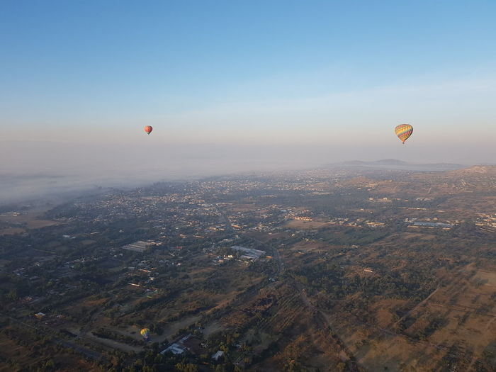 Aerial view of hot air balloon against sky