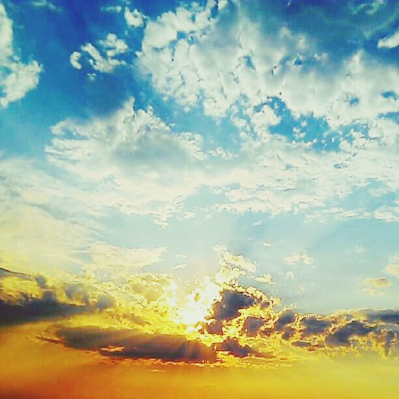 sky, nature, cloud - sky, beauty in nature, scenics, tranquil scene, no people, tranquility, sunset, sunlight, outdoors, yellow, day, backgrounds, blue