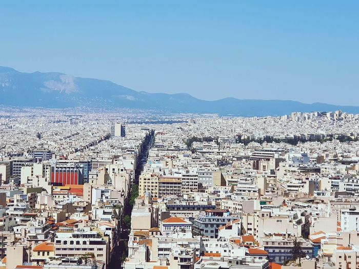 Athens 2018 Athens, Greece Athens Architecture City Life Whitebuildings Roads Urban Life Travelling Clear Sky Cityscape City Sea Sky Mountain Range Urban Scene Skyline Housing Settlement Residential District Tranquil Scene Building Adventures In The City