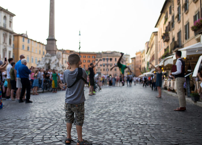 Child learning to take photos Camera Italy 🇮🇹 Learning Piazza Navona Rome Taking Photo Taking Photos Taking Pictures The Traveler - 2018 EyeEm Awards Travel Travel Photography Child Development Childhood Childhood Memories Cobblestone Crowd Development Group Of People Kids Activities Kids Learning Learning New Things Learning Photography Lifestyles Street Performer Travel Destinations