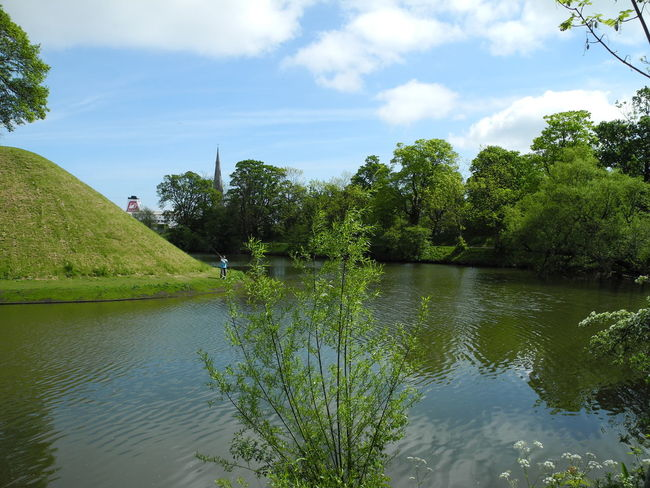 Moat around the Rampart of the Citadel in Copenhagen, Denmark - Water Tree Nature Plant Outdoors Cloud - Sky Sky No People Day Beauty In Nature Rampart Moat Spring Springtime Idyllic Sunny Kastellet København Danmark - at the Citadel in Copenhagen, Denmark