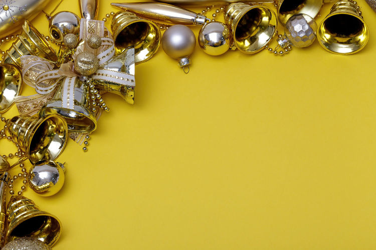 Close-up of electric lamp against yellow background