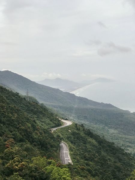 Vertical Travel Destinations Tourist Attraction  Vietnam Mountain Road Sea Road Mountain Beauty In Nature Scenics - Nature Tranquil Scene Sky Plant Cloud - Sky Tranquility Environment Nature No People Tree Landscape Mountain Range Land Non-urban Scene Growth Outdoors Green Color