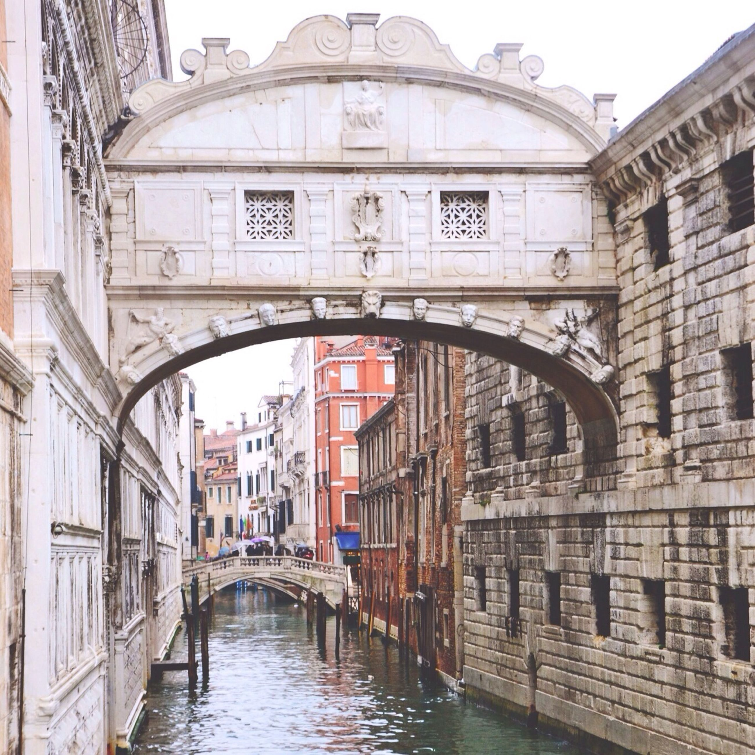 architecture, built structure, building exterior, water, arch, canal, connection, bridge - man made structure, waterfront, building, residential building, river, residential structure, bridge, city, arch bridge, reflection, window, day, railing