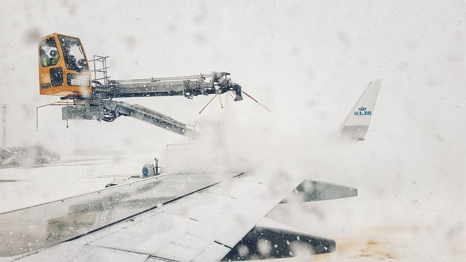 Defrost on a plane. Snow Airplane Airplane Wing KLM Winter Ice White Cold EyeEm Selects People Day Outdoors