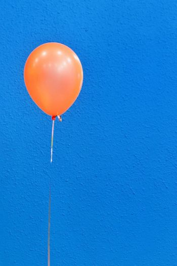 Orange balloon in front of blue wall Party - Social Event Party Time Happy Birthday! Lonliness Blue Background EyeEm Selects Balloon Blue Copy Space Mid-air Helium Balloon No People Single Object Flying Celebration Colored Background Event Close-up Helium Party - Social Event Orange Color Wall - Building Feature