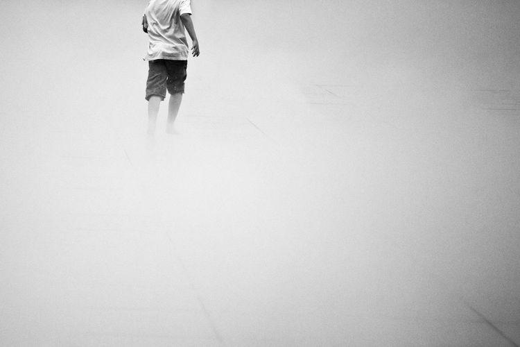 Run Blackandwhite Boy Childhood Foggy Game Kid One Person Outdoors People Streetphotography Water EyeEmNewHere