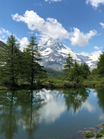 View of Matterhorn from Five lakes walk above Zermatt Matterhorn  Copy Space Alpine Landscape Reflection Water Sky Tree Plant Cloud - Sky Lake Beauty In Nature Mountain No People Tranquil Scene Tranquility Scenics - Nature Outdoors Non-urban Scene Nature Day Idyllic Growth