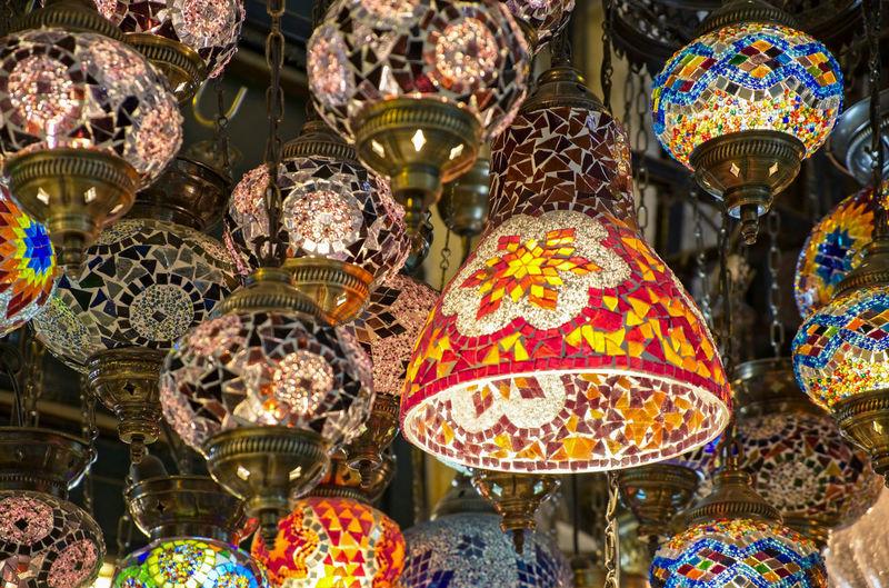 Close-up of lantern hanging at market stall
