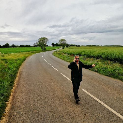 Full length of a man standing on road
