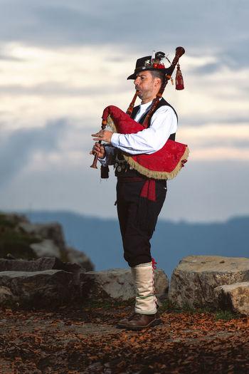 Mature man playing bagpiper outdoors