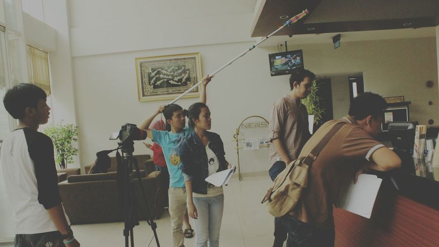 A candid photo Filming Teamwork Home Video Camera Candid