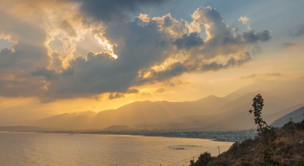 Sunrise over Malia in Crete Cloud - Sky Clouds Morning Sunrise Chersonissos Greece Crete Sky Beauty In Nature Scenics - Nature Water Cloud - Sky Sunset Tranquility Tranquil Scene Sea Idyllic Non-urban Scene No People Outdoors Orange Color Beach Mountain