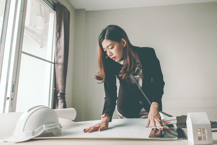 Young woman working on table