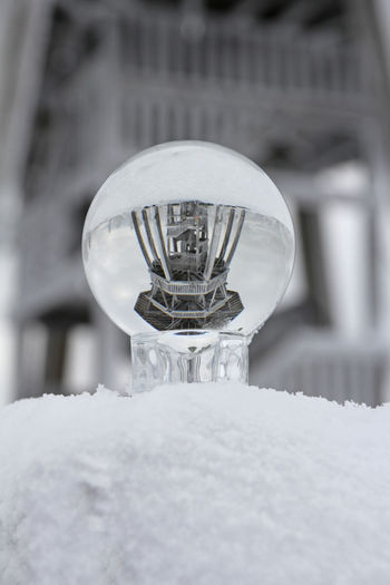 Close-up of light bulb on snow