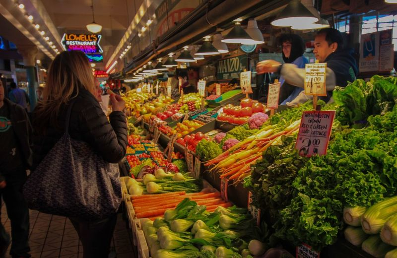 Alll the veggies Market Retail  Food And Drink Market Stall Women Food Real People Vegetable Freshness Shopping Buying Healthy Eating Incidental People Choice Lifestyles Customer  For Sale Business Variation