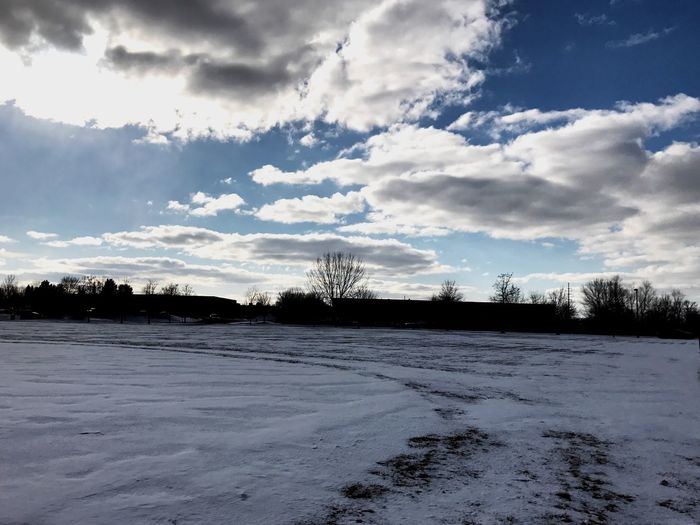 Scenic view of landscape against sky during winter