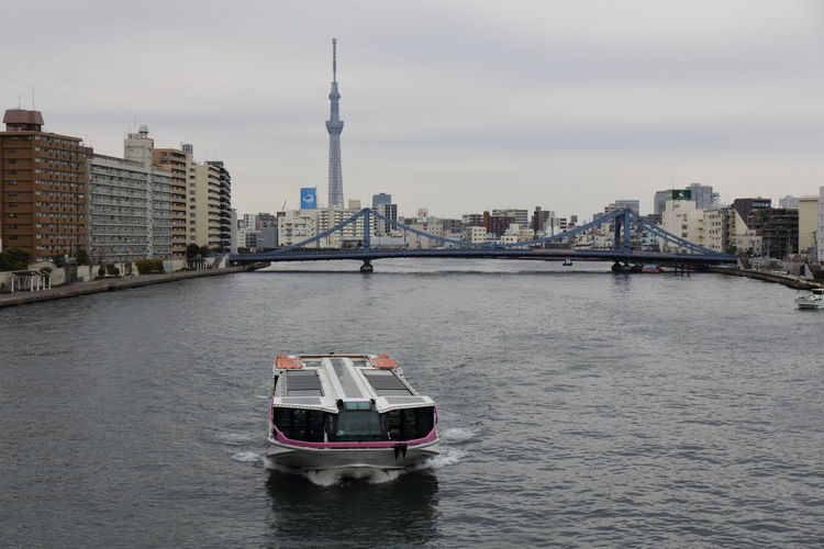 Boat In River With City In Background