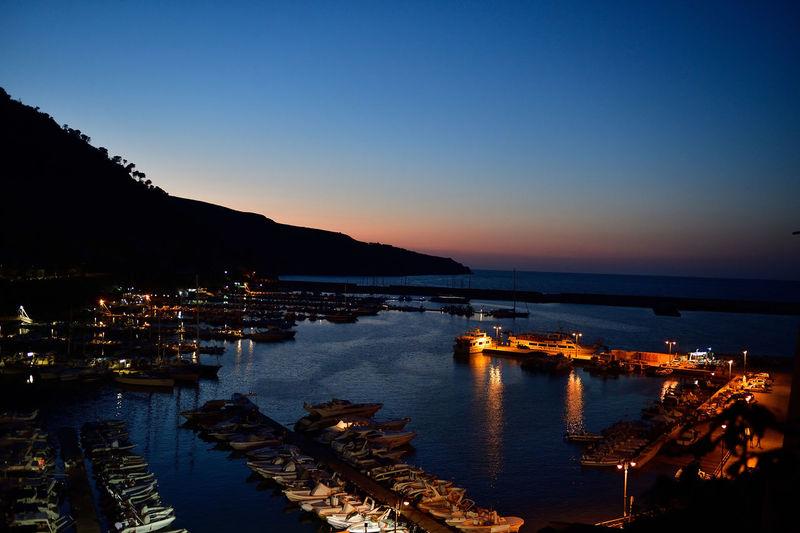 View of harbor at night