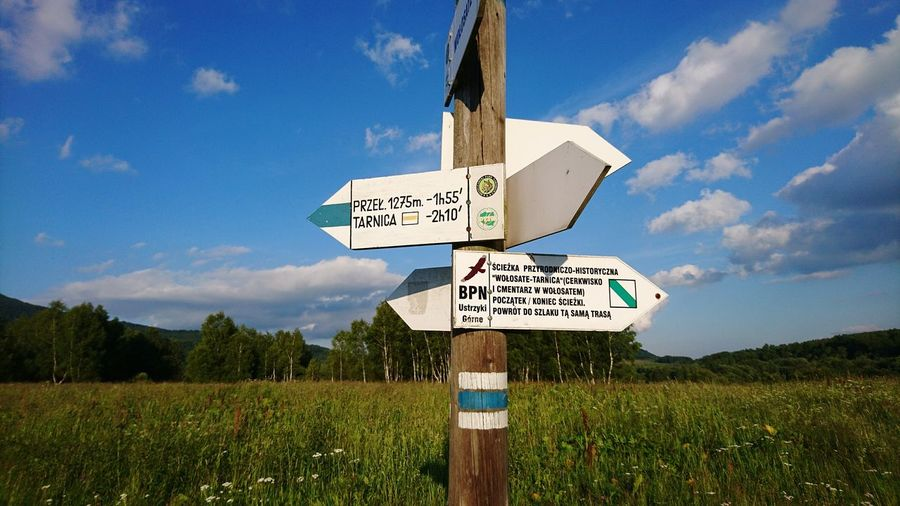 EyeEm Selects Guidance Text Road Sign Communication Sky Cloud - Sky Day Outdoors No People Agriculture Rural Scene Grass Nature Close-up This Way Road To Mountains Bieszczady