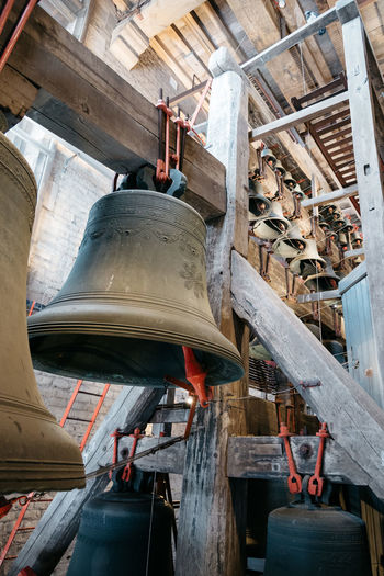 Bells mechanism of Cathedral of Mechelen. Some of the original carillon's set of 49 bells are still in working order. Architecture Beauty In Nature Belgium Bell Bell Tower Brass Carillon Carillontower Cathedral Church Clock Clock Tower Day Indoors  Mechanical Mechanism Mechelen Music Old Religion Sound Technology Tower Travel Vintage