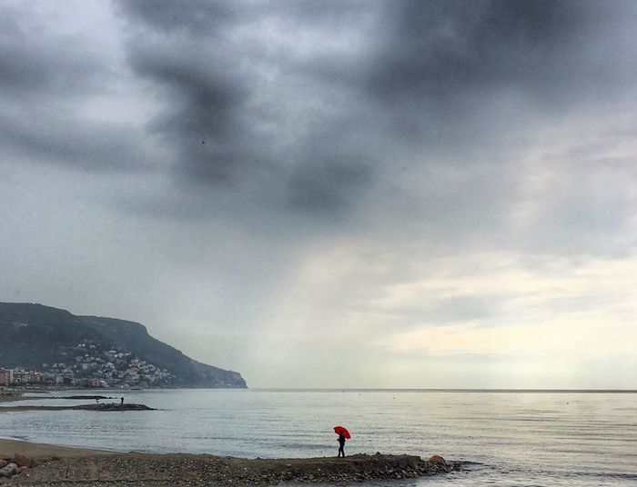 Seascape Rain Sky Cloud - Sky Sea Water Beach Beauty In Nature Land Horizon Horizon Over Water Tranquility Mountain One Person Outdoors