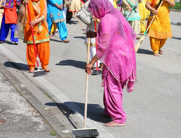 Sikh religion women during the ceremony along the streets of the city while sweeping the road Brooms  Celebration Ceremonial Cleaner Cleaning Punjab Road Sikhi Woman Ceremony Female Group Guru Nanak Parade Procession Punjabi Religion Sikh Sikhism Sikhlife Sikhs Street Sweep Sweeping Women