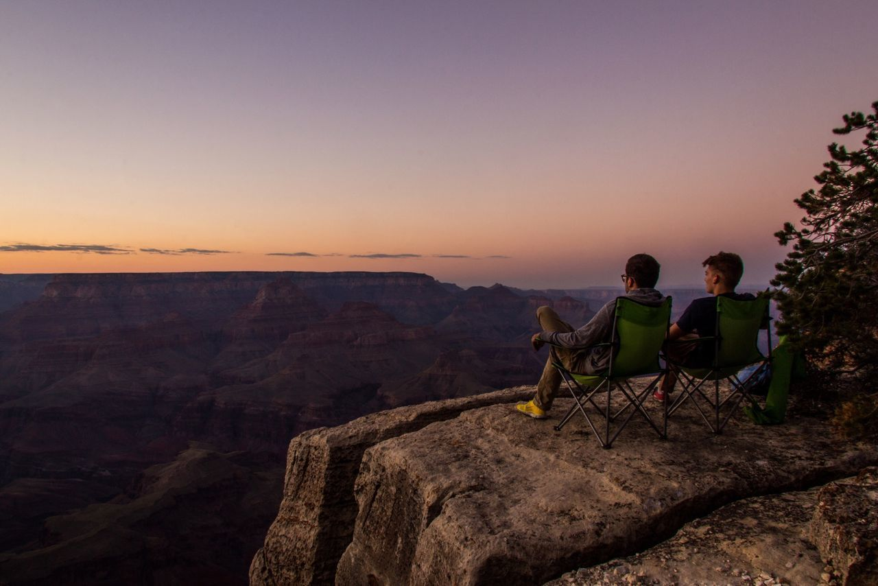 Two men looking at grand canyon