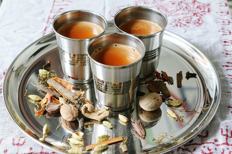 Masala tea, made of brewed black tea and milk some spices and herbs Indoors  Food And Drink Healthy Eating Tablecloth No People Freshness Day Close-up Food some spice and herbs Nepalese Nepali  Nepali Food