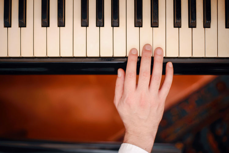 Hand of piano player Artist Arts Culture And Entertainment Body Part Close-up Finger Hand Human Body Part Human Finger Human Hand Human Limb Indoors  Keyboard Keyboard Instrument Music Musical Equipment Musical Instrument Musician People Pianist Piano Piano Key Playing Skill