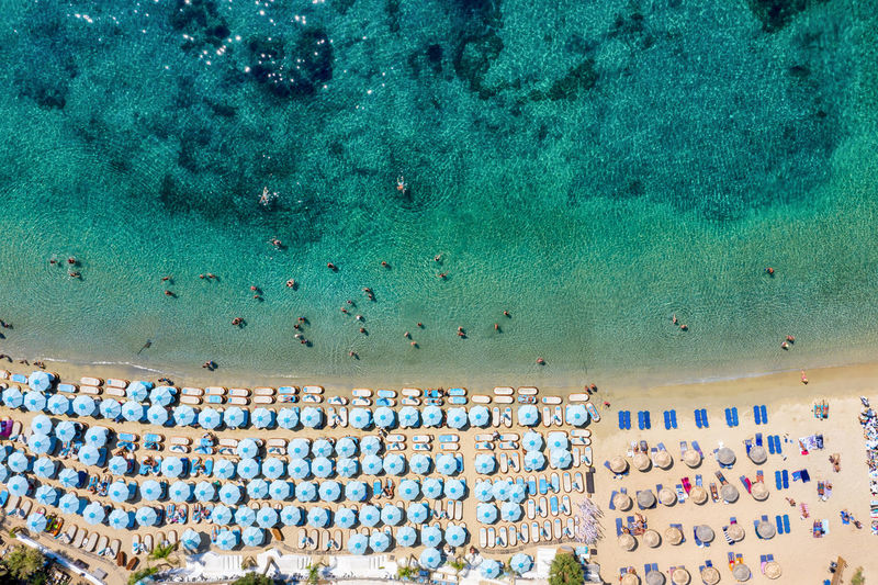 High angle view of people in sea during summer