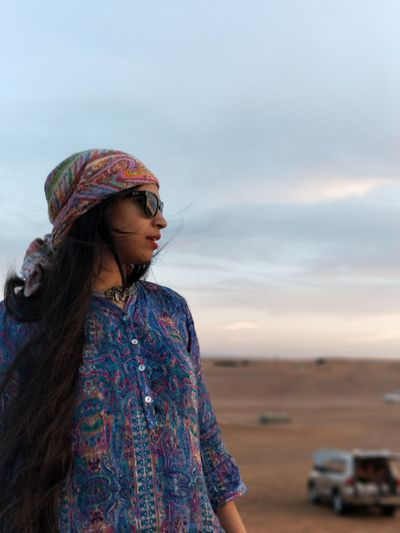 EyeEm Selects Only Women One Woman Only One Person Adults Only Adult People Outdoors Mature Adult Standing Sky Beach Day Women One Mature Woman Only Portrait Smiling Beautiful Woman Lifestyles Young Adult Young Women Sand Deserts Around The World Desert Summer Road Tripping