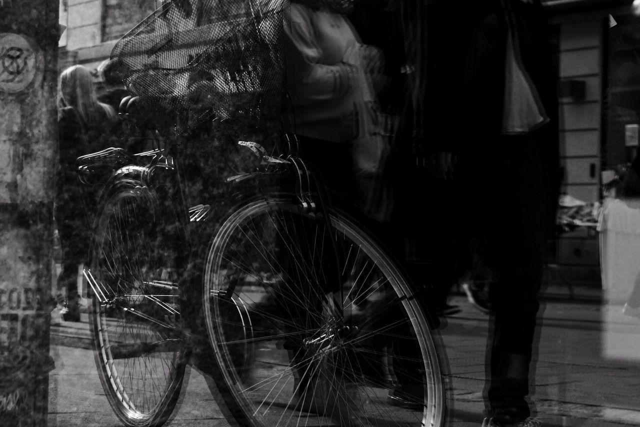 bicycle, real people, transportation, mode of transport, street, land vehicle, outdoors, men, lifestyles, road, night, building exterior, city, low section, architecture, one person, people