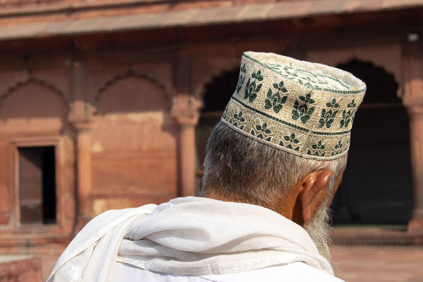 Imam at Jama Masjid Mosque Delhi Headshot One Person Rear View Portrait Architecture Adult Real People Focus On Foreground Belief Religion Lifestyles Traditional Clothing History Day Jama Masjid Delhi Mosque Islam