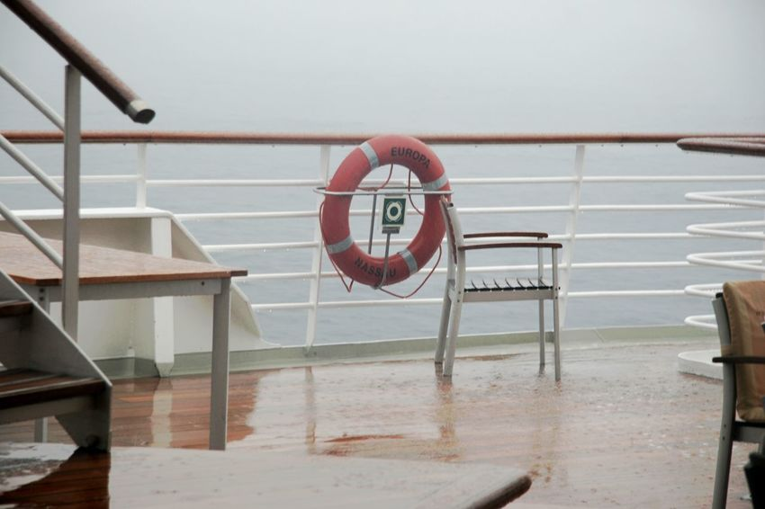 Boat Deck Cruise Ship Day Life Belt No People Outdoors Protection Railing Rainy Day Red Safety Water Wet Deck