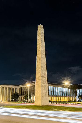 Night view of the Marconi obelisk, iconic landmark in the EUR district, Rome, Italy Architectural Column Architecture Built Structure Capital Cities  City City Life Cloud - Sky Column Engineering Illuminated Low Angle View Modern Night No People Outdoors Sky Tall - High Tourism Travel Destinations