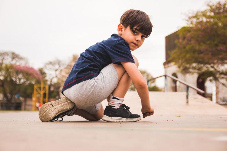 Portrait of boy on walkway