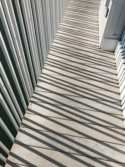 Rail shadows on walkway Angles Black Color Built Structure Contrast Day Gray Linear Natural Light No People Nobody Outdoors Pattern Phone Camera Rails Shadows Sunny Textures Vertical White Wood