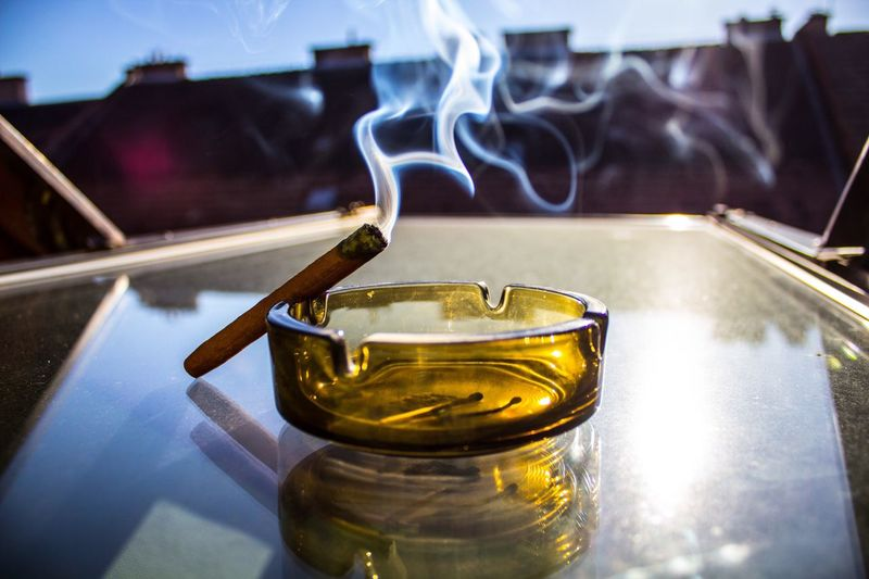 Close-Up Of Cigar In Ashtray On Table