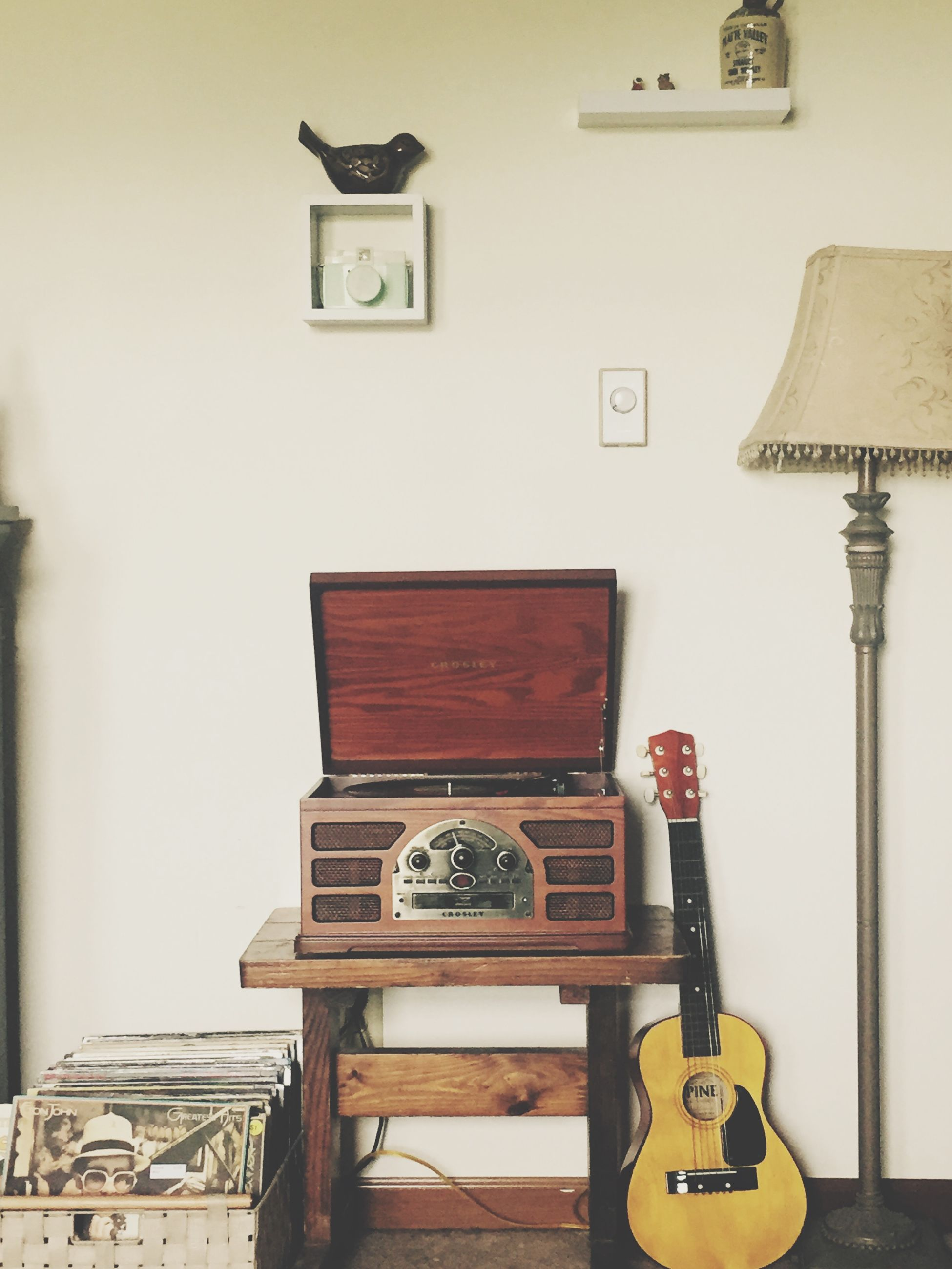 indoors, communication, wall - building feature, retro styled, old-fashioned, technology, wood - material, text, table, close-up, still life, no people, home interior, telephone, door, wall, antique, old, metal, western script