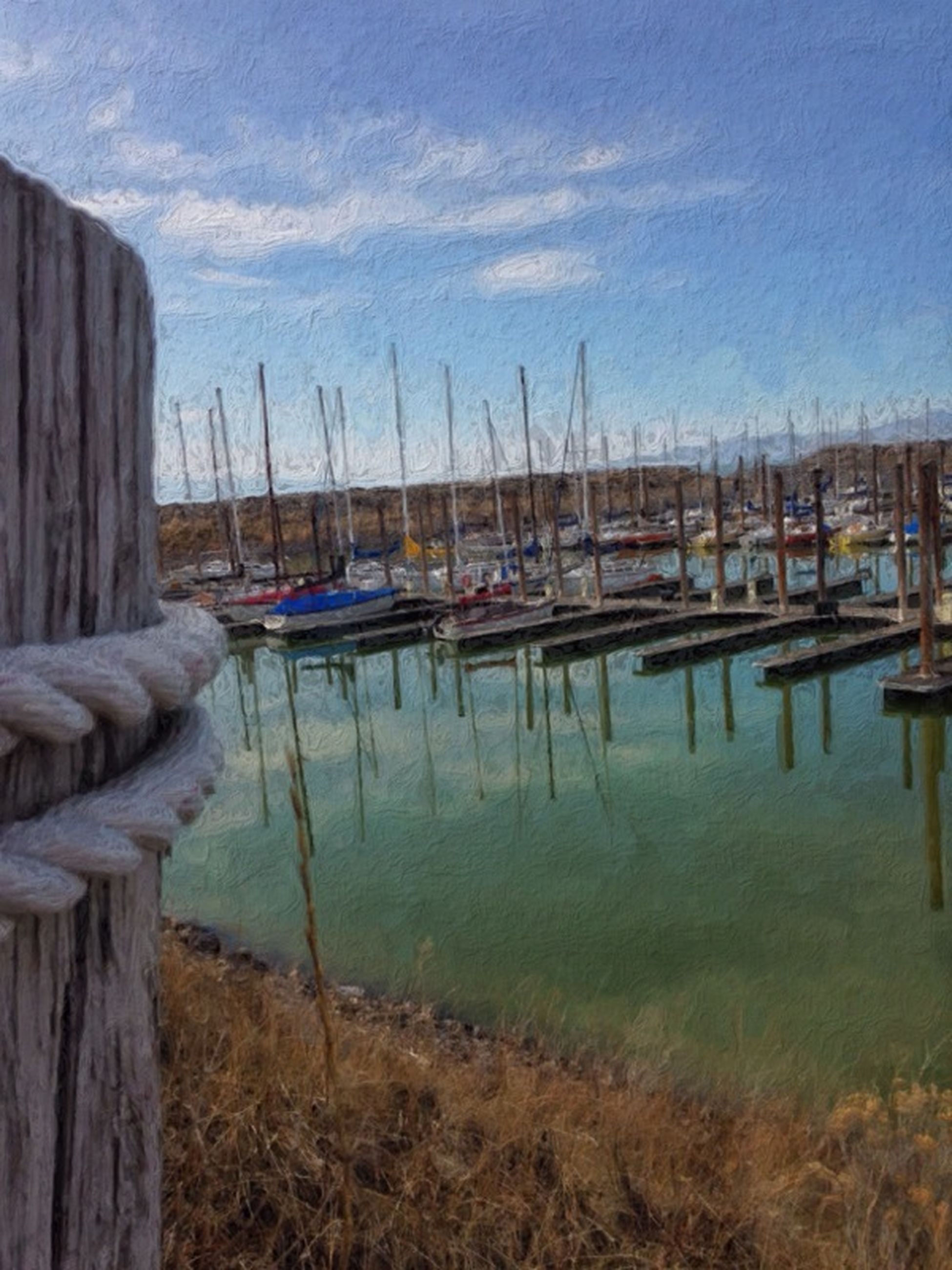 nautical vessel, moored, boat, transportation, water, mode of transport, harbor, mast, sky, sailboat, sea, reflection, lake, tranquility, rope, nature, tranquil scene, blue, outdoors, day