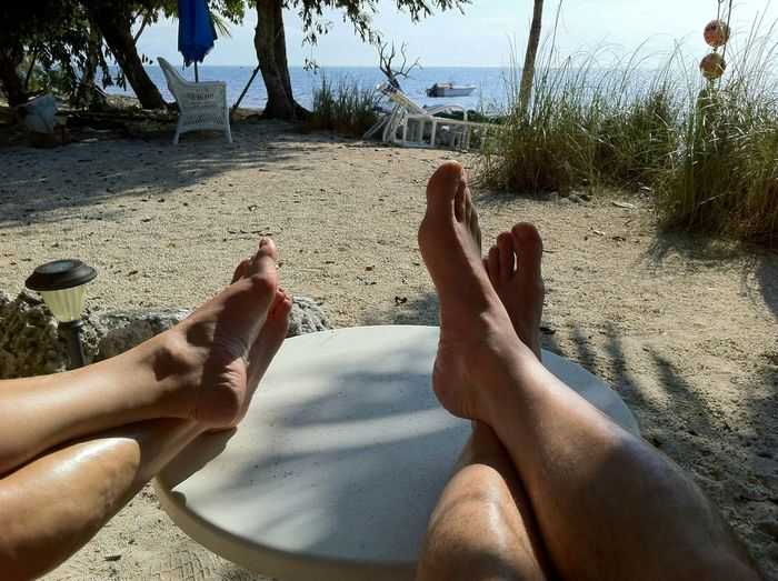Barefoot Beach Vacations Leisure Activity Personal Perspective Oceanside Waterfront Vacations Tranquility Florida Keys Palm Tree Big Pine Key Tropical Climate Two People Sand Real People
